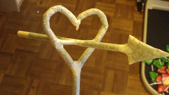 Dude rolls his valentine an impressive heart-shaped joint